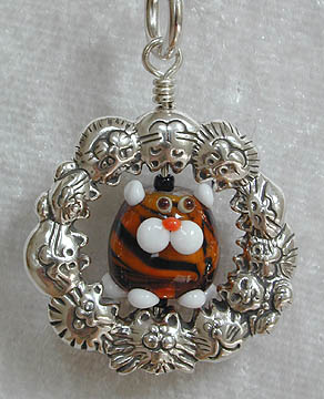 Tiger Weeble Kitty framed in a Kitty Charmer